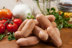 Sausages on cutting board Royalty Free Stock Photo