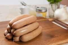 Sausages on cutting board Stock Photos