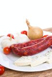Sausages with Danish blue cheese and vegetable Stock Images