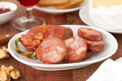 Sausages on dish Stock Images