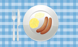 Sausages in dish Stock Images