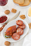 Sausages on dish with wine Royalty Free Stock Photography