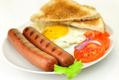 Sausages with egg Stock Image