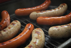 Sausages on electric grill Royalty Free Stock Photography