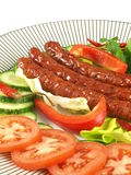 Sausages - fat food. Unhealthy meal, fat  sausages, hard to digest, salty Stock Photography