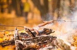 Sausages at fireplace