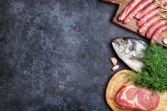 Sausages, fish and meat cooking Stock Image