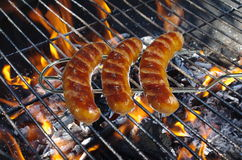 Sausages on fork Stock Photos