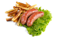 Sausages with french fries Royalty Free Stock Photos