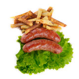 Sausages with french fries Royalty Free Stock Photo