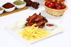 Sausages and french fries Royalty Free Stock Images