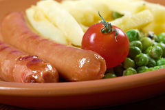 Sausages with french fries Stock Photo