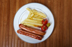 Sausages with french fries Royalty Free Stock Photography