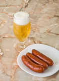 Sausages with a fresh beer Royalty Free Stock Photo