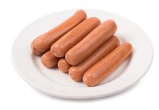 Sausages fresh in a plate. Isolate Royalty Free Stock Images
