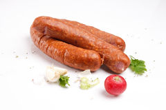 Sausages with fresh vegetables Royalty Free Stock Photography