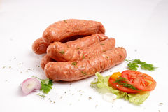 Sausages with fresh vegetables Royalty Free Stock Photo