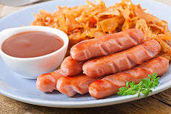 Sausages and fried cabbage Royalty Free Stock Photos