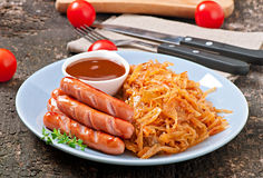 Sausages and fried cabbage Stock Images