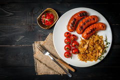 Sausages and fried cabbage Stock Photography