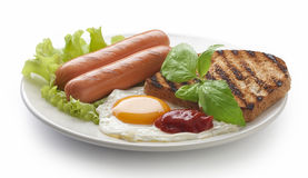 Sausages with fried egg and toast Stock Photo