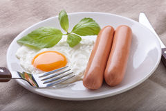 Sausages with fried egg Stock Photography