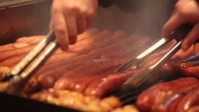 Sausages are fried on a lattice stock video footage