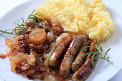 Sausages Fried Onions And Potato Royalty Free Stock Photos