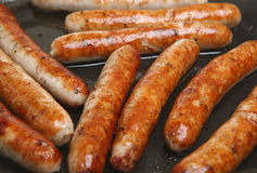 Sausages Frying Stock Photo