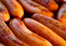 Sausages frying Royalty Free Stock Images