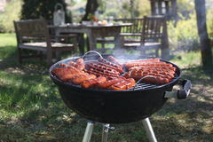 Sausages frying on a grill Stock Images