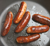 Sausages Frying in Pan Stock Photography