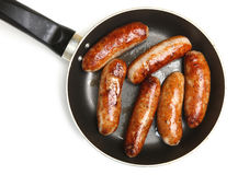 Sausages in Frying Pan Isolated on White Stock Images