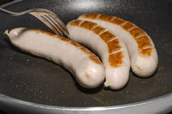 Sausages in a frying pan Stock Image