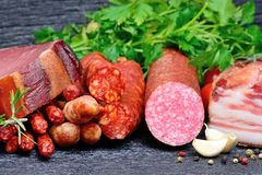 Sausages with garlic and herbs on table Stock Images