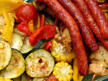 Sausages and gratin. Gratin vegetables with sausages Royalty Free Stock Images