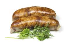 Sausages and greens Stock Photos