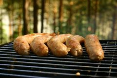 Sausages on a grill royalty free stock image