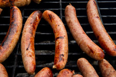 Sausages on grill Royalty Free Stock Photo