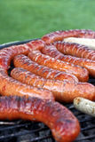 Sausages on grill. Stock Photo