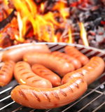 Sausages on a grill. Royalty Free Stock Photos