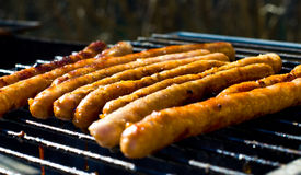 Sausages on grill Royalty Free Stock Photos