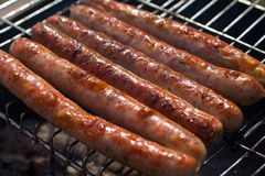 Sausages on grill Royalty Free Stock Images