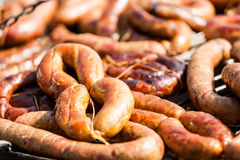 Sausages on the grill Stock Images