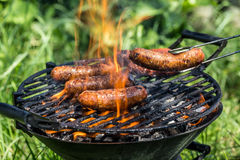 Sausages on the grill Stock Photo