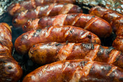 Sausages on the grill. Closeup of the sausages on the grill stock images