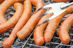 Sausages on the grill stock photos