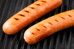 Sausages on a grill Royalty Free Stock Photo