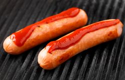 Sausages on a grill Royalty Free Stock Images