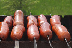 Sausages on the grill Royalty Free Stock Image